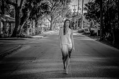 Greyscale Photo of Woman Standing on Street Royalty Free Stock Photo