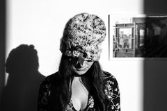 Greyscale Photo of Woman Wearing Knitted Hat and Floral Long-sleeved Top Stock Image