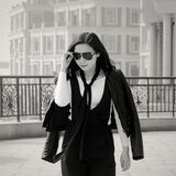 Greyscale Photo of Woman Wearing Sunglasses Long Sleeves Shirt and Skirt during Daytime Stock Image