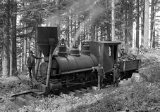 Greyscale Photography of 3 Person Beside Train on Forest Royalty Free Stock Images