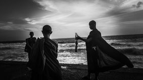 Greyscale Photography of Three Monks Near Ocean Stock Photos