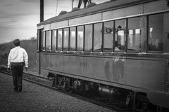 Greyscale Photography of Train Beside Woman Stock Photos