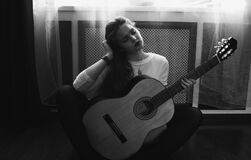 Greyscale Photography of Woman in Crew Neck Long Sleeve Shirt Holding Guitar Stock Photography