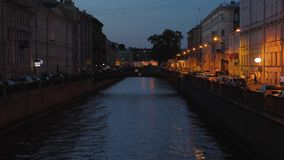 The Griboedov canal and the city skyline at dusk Saint Petersburg, Russia. Night view. The Griboedov canal and the city skyline at dusk Saint Petersburg, Russia stock footage