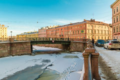 Griboedov Canal and Kokushkin Bridge in winter scene. St. Petersburg, Russia - February 18, 2016: Winter scene on the embankment. Griboyedov Canal and Kokushkin Stock Photo
