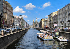 Griboedov Canal in Saint Petersburg, Russia. View of the Griboedov Canal with sightseeing boats and Church of the Savior on Blood in Saint Petersburg, Russia Royalty Free Stock Photo