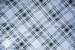 Grid on blue satin fabric Royalty Free Stock Photos