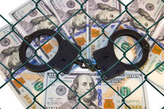 Grid on the blurred background of money with handcuffs. Stock Images