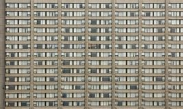 Grid building background. Close-up of a building. Grid of high-rise building windows stock photos