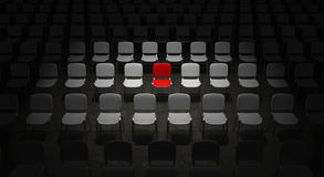 Grid of Chairs with a red Chair standing out Stock Image