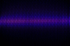 Grid with colors. A black grid backed by blue and purple light Stock Photo
