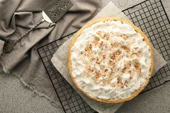 Grid with delicious coconut cream pie. On grey table Stock Image