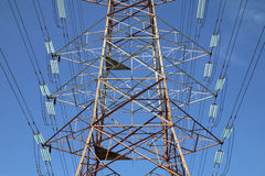 Grid electricity transmission tower. Against blue sky royalty free stock images