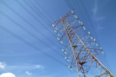 Grid electricity transmission tower - Series 3. Grid electricity transmission tower against blue sky royalty free stock photography