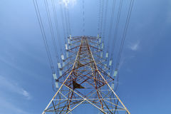 Grid electricity transmission tower - Series 5. Grid electricity transmission tower against blue sky royalty free stock photo