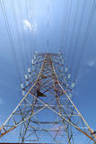 Grid electricity transmission tower - Series 6. Grid electricity transmission tower against blue sky royalty free stock photos