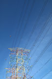Grid electricity transmission tower - Series 8. Grid electricity transmission tower against blue sky stock photo