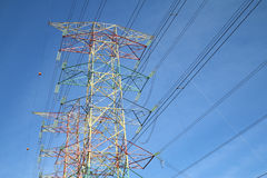 Grid electricity transmission tower - Series 9. Grid electricity transmission tower against blue sky royalty free stock photo