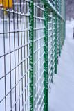 Grid fence in the snow stock photo