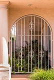 Grid gate. White painted cast iron grid gate to the garden, closed Stock Image