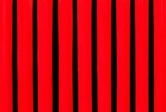 Grid grille in the hood of vintage car close up.Red black metal background. Grid grille in the hood of vintage car close up Stock Photos