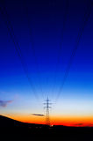 High voltage pillars at dusk. A grid of high voltage pillars at dusk Stock Image