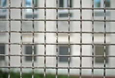 Grid iron to defend the prison with prisoners Royalty Free Stock Images