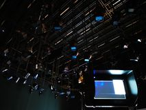 Grid of lights and video camera viewfinder. In a television studio stock photo