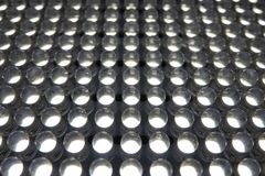 White LED Light Bulbs Array Up Close in Rows and Columns. A grid-like array of small, white LED lights is on display up close Stock Photography