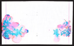 Colorful ink blots on copybook Stock Images