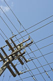 Grid of power lines on pole. Looking up at crisscross grid of power lines on pole stock photography