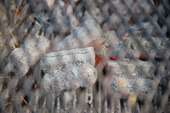 Grid and red hot coals for grill Stock Photo