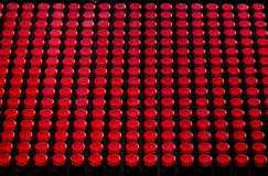Grid of red knob-like lights Royalty Free Stock Photo