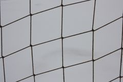 Grid of rope on the background of snow Royalty Free Stock Photos