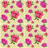 Grid seamless flowers. Seamless structure in the form of red petunia flowers and bright pink chrysanthemum on the background of intersecting yellow crumpled Royalty Free Stock Photo
