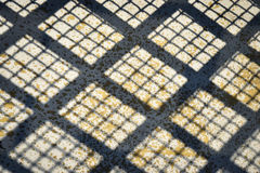 Grid shadow on concrete Stock Photo