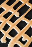 Grid shaped cookies Royalty Free Stock Image