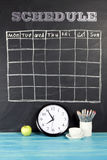 Grid timetable schedule on black chalkboard background. Grid timetable schedule on black chalkboard background royalty free stock images