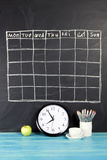 Grid timetable schedule on black chalkboard background. Grid timetable schedule on black chalkboard background royalty free stock photography