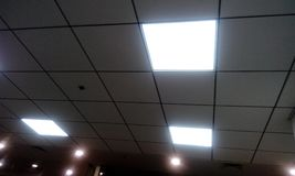 Grid type false ceiling in office building. Grid false ceiling in an office building with Grid lighting in business hours of working time and images taken during stock photography
