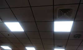 Grid type false ceiling in office building stock image