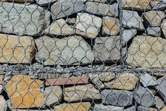 Grid wall and texture stones. Background of grid wall and texture stones outside Royalty Free Stock Photography
