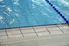 Grid for water circulation in swimming pool Stock Image