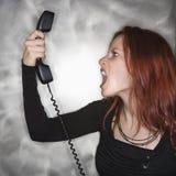 Gridando nel telefono. Immagine Stock Libera da Diritti