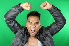 Gridare asiatico dell'uomo Immagini Stock