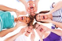 Gridare degli amici Fotografia Stock