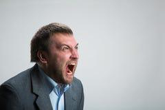 Gridare dell'uomo d'affari Fotografie Stock