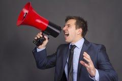 Gridare di profilo del megafono dell'uomo d'affari di altoparlante Fotografia Stock Libera da Diritti