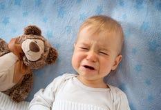 Gridare di un anno del bambino Immagini Stock