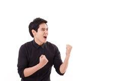 Gridare felice dell'uomo del vincitore Fotografie Stock Libere da Diritti